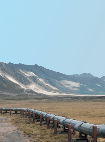 Oil pipeline in front of mountains